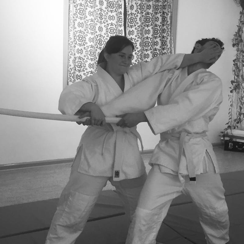 Aikido beginner doing bokken dori