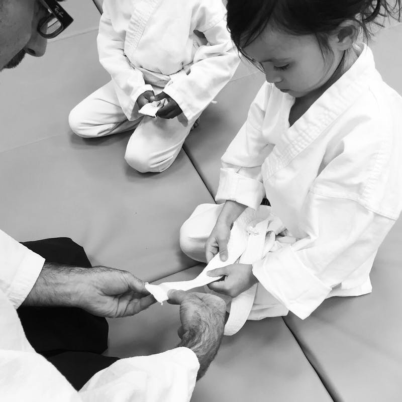 Awarding stripe for a passing Aiki Kids student at Brooklyn Aikido Center.