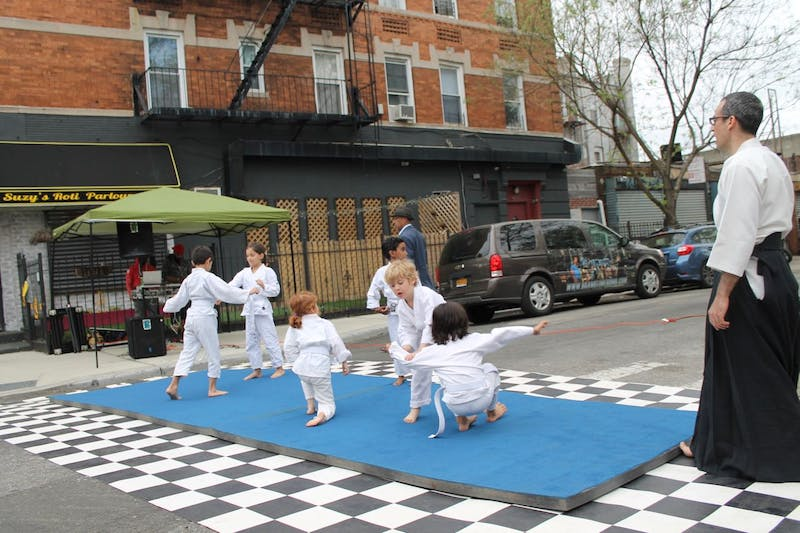 Youth Aikido demonstration showcasing technique at the 2018 Church Ave Street Fair in Brooklyn, NY